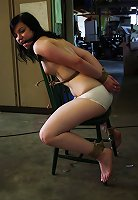 No chances of escaping for the gagged girl in white panties: abductor tied her helplessly to the chair